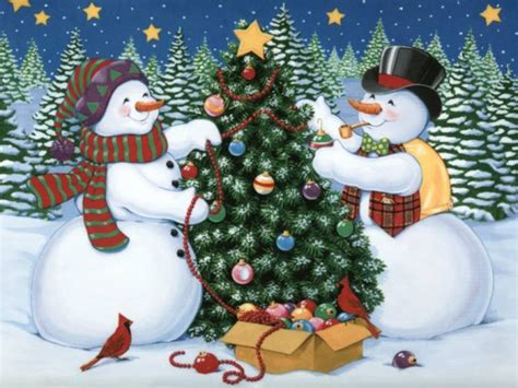 snowmen decorating a tree pictures photos and