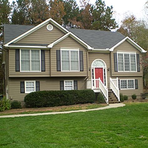 earth tones exterior house paint house door brown with black shutters which