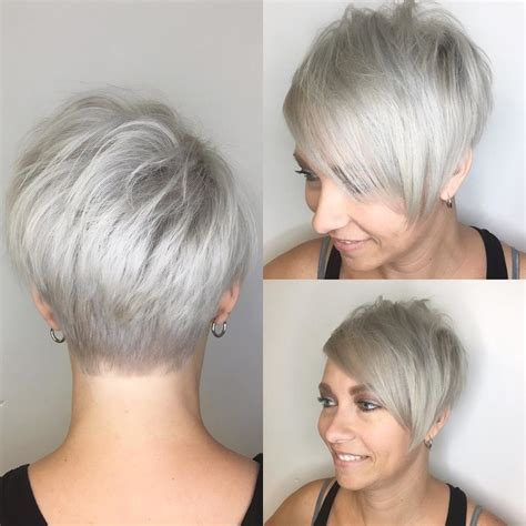 platinum pixie haircut for 42 year old women s polished platinum asymmetrical textured pixie with