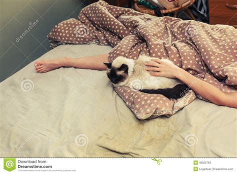 kitten in bed woman and cat in bed stock photo image 46052763