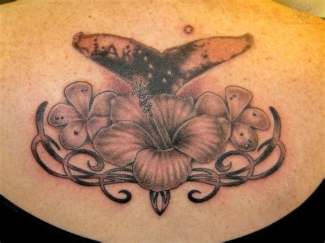 tribal thong tattoo whale flower