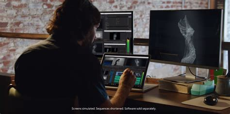 a new year television ad features a in a parade fresh microsoft surface book tv ads emphasize creative and