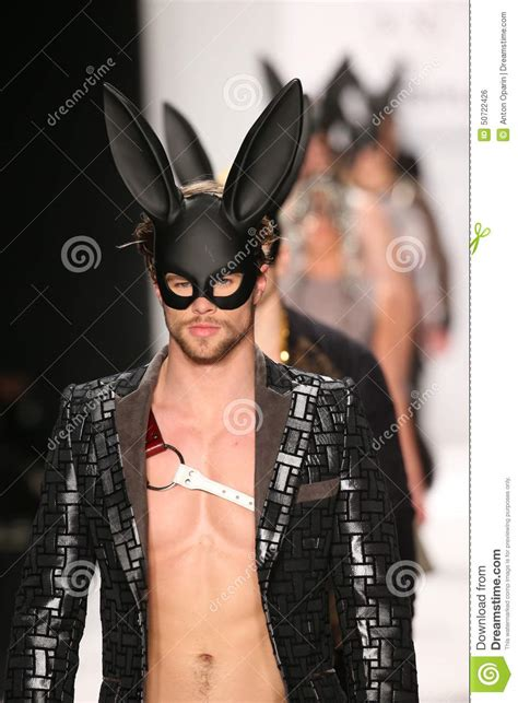 the painting fashion show models walk the runway in a mister x design at the