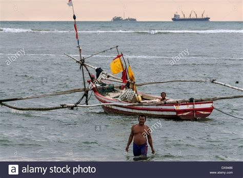 fishing boat with outriggers fishing boat with outriggers at sunset bengkulu