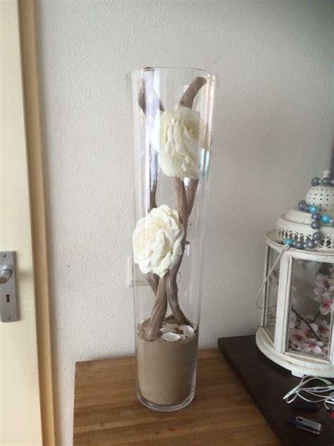 gave vaas met rozen takken en zand mit bildern