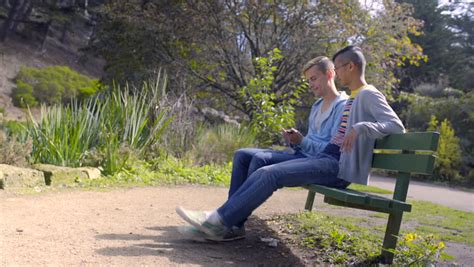 fucking on park bench gay couple chat on park bench then take a photo together 4k stock video clip