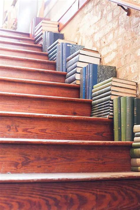 book stacking ideas place books on your staircase not the shelf popsugar home