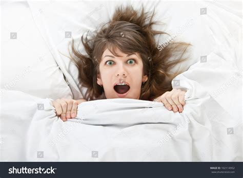 girl in bed beautiful girl bed home hiding under stock photo 102114952