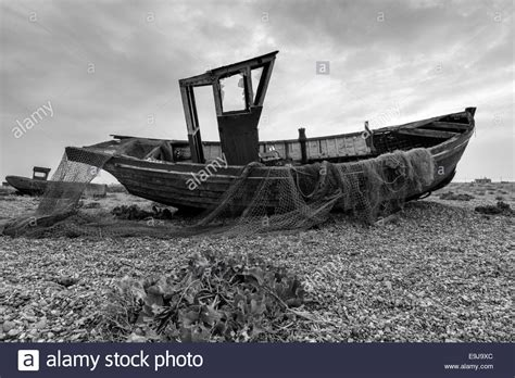 old fishing boat images an old fishing boat with nets in black and white stock