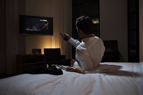 watching tv in bed enseo lets hotel guests watch netflix for free time