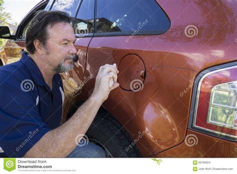 insurance adjuster taking photos of damage stock photo