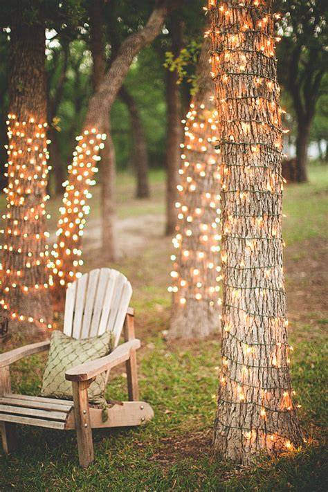 here s a great idea wrap fairy lights around tree trunks