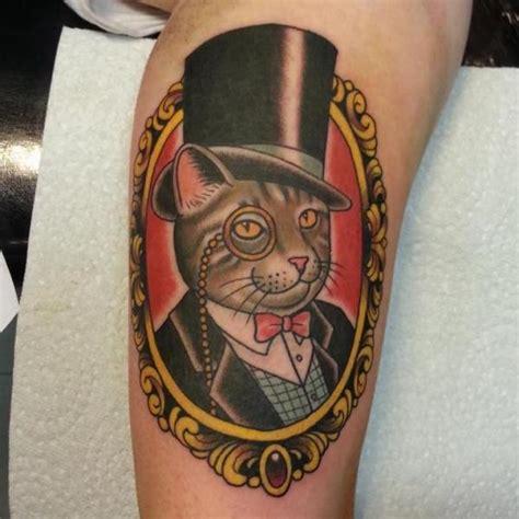 tatuagem fantasia gato medalh 227 o por spilled ink tattoo