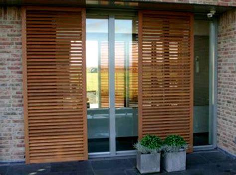imágenes fachadas minimalistas puertas de corredera de madera