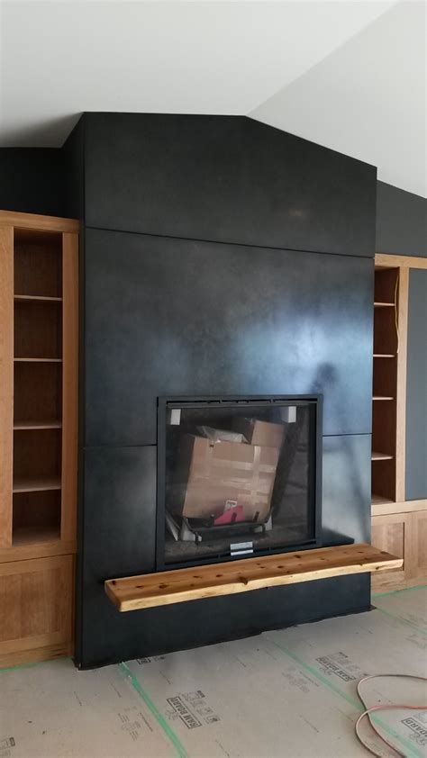 blackened steel fireplace surround and hearth support