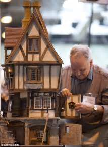 dolls house shows amazing handcrafted miniature creations showcased at miniature exhibition at