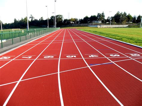 Sport Track polymeric surfacing polymeric sports surfaces