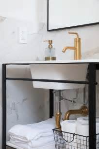 sunburst mirror with gold trim transitional bathroom