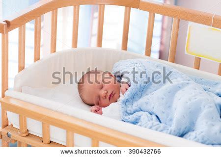 side bed for baby newborn baby in hospital room new born child in wooden co