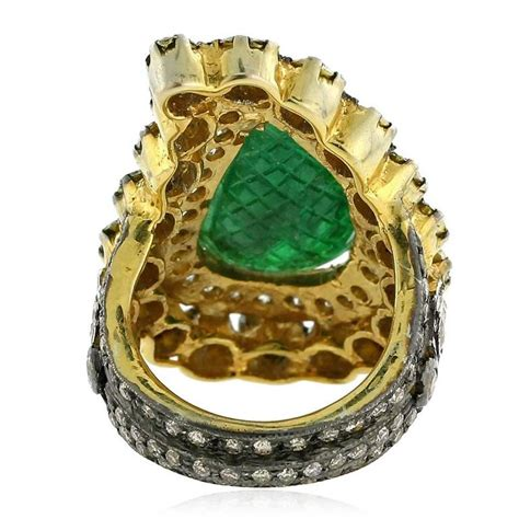 paisley shaped carved emerald gold ring for sale