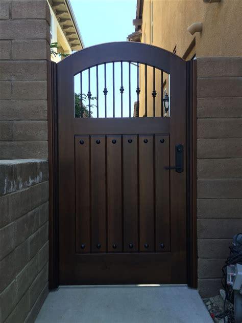 custom wood gate  decorative metal pickets  garden