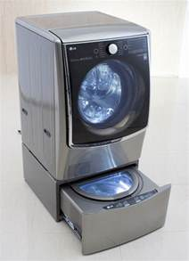 Lg Washing Machine Pedestal lg s new washing machine cleans two different loads at once daily mail