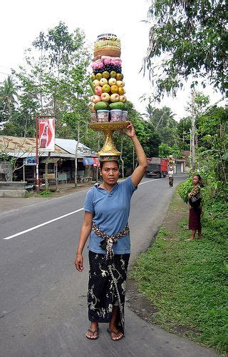 balinese woman carrying items   head bali indonesia