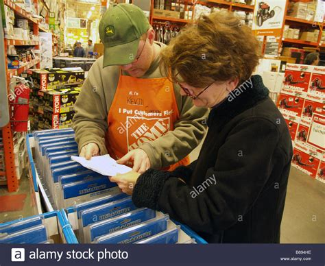 shopper receiving help from a sales associate at a home