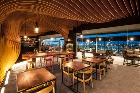home design store jakarta wavy timber slats delivering a cave like feel new six degrees cafe in jakarta2014 interior