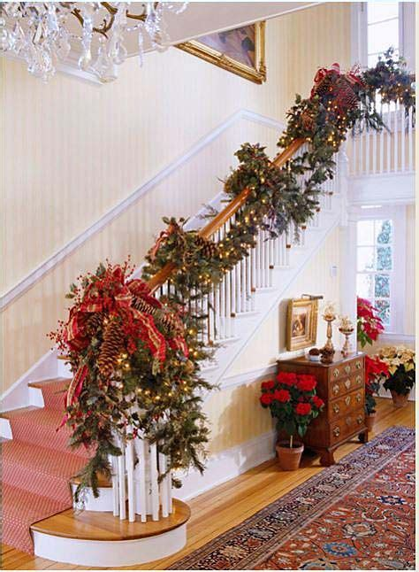 banister decorating ideas 12 beautiful staircases to sneak down on christmas eve