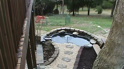 installing a backyard pond how to install a raised koi pond with water course