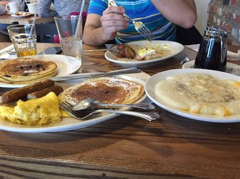 eggs benedict and cheese grits at terrace cafe picture triple stack blueberry pancakes eggs cheese grits