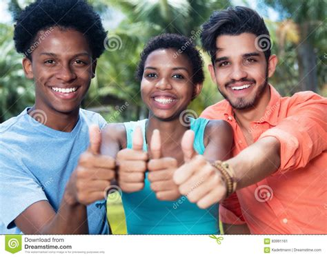 hipster male student showing thumb group stock photo group of laughing african american and latin man and woman