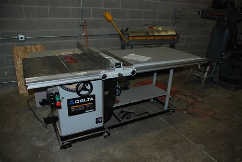 Delta Unisaw Table Saw by Lifting A Delta Unisaw