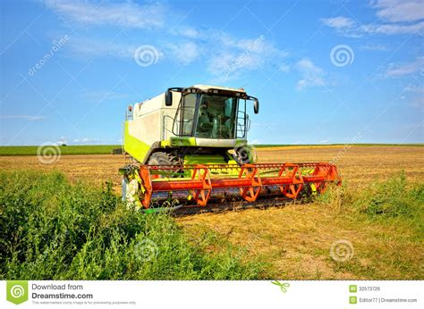 Steunk Combines Modern Tech With Elements by Modern Combine On A Wheat Field Royalty Free Stock Image