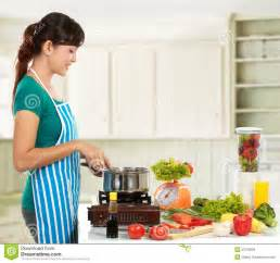 in the kitchen woman cooking in the kitchen royalty free stock images image 23130929