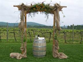 decorated wedding arch with burlap and sunflowers perfect