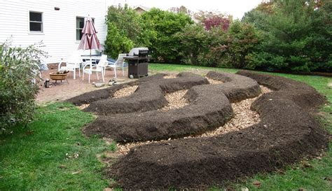 how to stop water runoff from neighbors yard raised beds ecologia design 240 344 5625