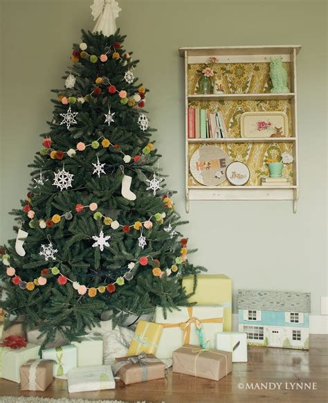decorating with poms poms at christmas pom pom garland