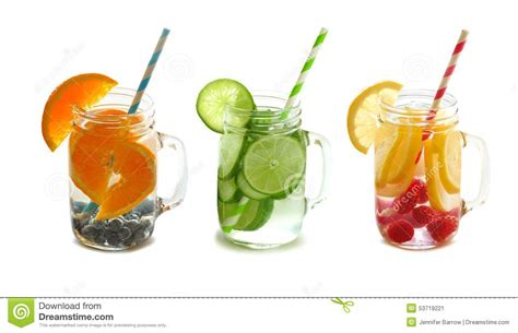 Detox Drinks White Background by Detox Fruit Water In Jars With Straws Isolated Stock