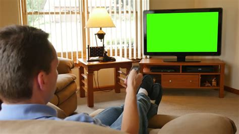 living room tv channel 10 watches tv television green screen living room stock footage 7208701