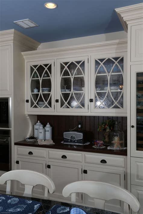 back painted glass kitchen cabinet doors white painted hutch cabinetry with curved mullions and