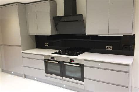 Modern Black Kitchen jet black glass splashback amp window sill in modern kitchen