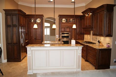brown kitchen cabinets with white island quicua com