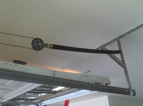How To Install Garage Door Springs Overhead How Much Should A Garage Door Replacement Cost Home Garage Doors Angie S List Project