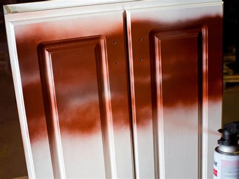 Best Way To Spray Cabinet Doors by How To Paint Kitchen Cabinets With A Sprayed On Finish