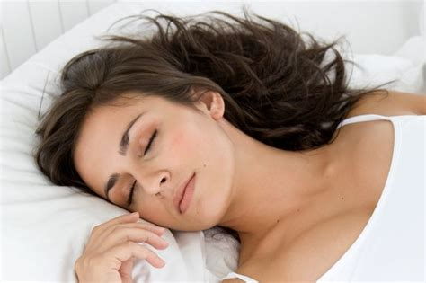woman sleeping in bed women need more sleep more than men because they do more