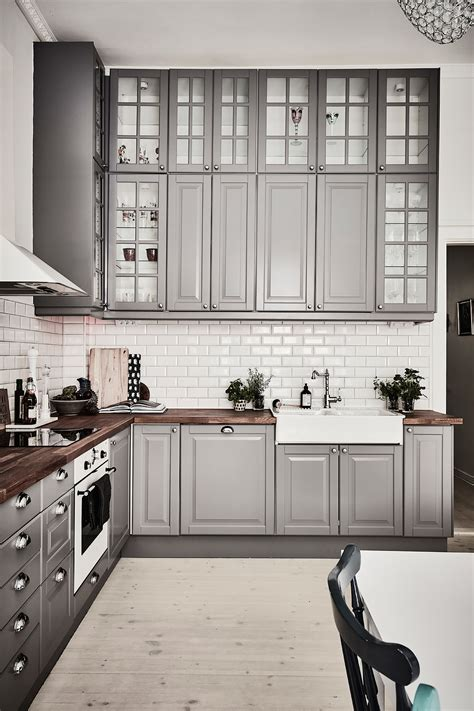 Inspiring Kitchens You Won T Believe Are Ikea Gray Ikea Black Kitchen Cabinets