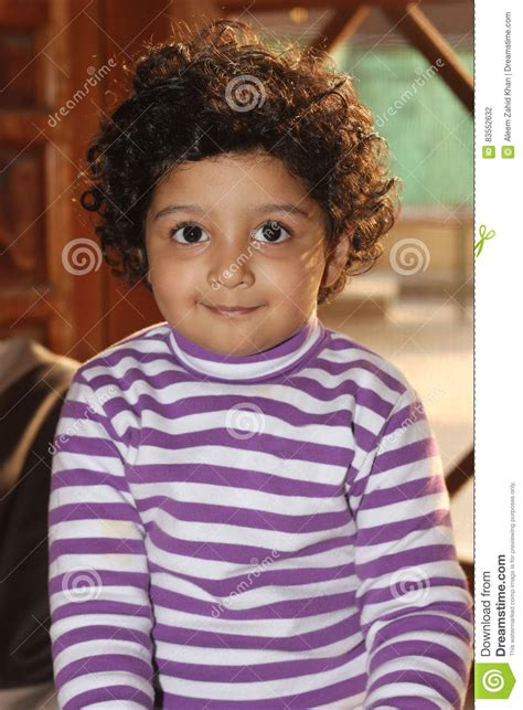light skinned boys with long curly hair cute curly hair light skin south asian boy stock photo