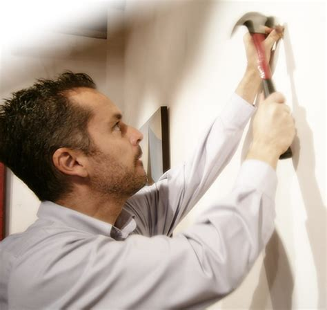 hang a picture how to hang a painting a free guide from xanadu gallery